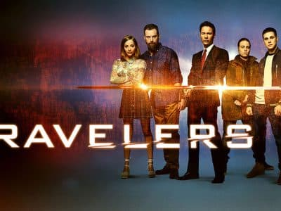 Characters from the TV show Travelers staring at the camera