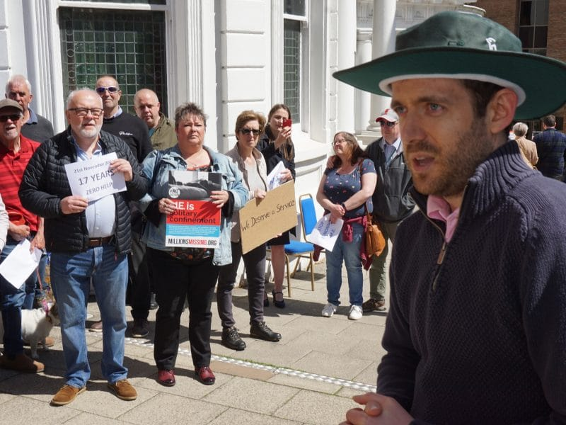 Juan Corlett speaking at the ME protest